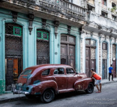 Old cars & buildings in Vedado, Havana, Cuba