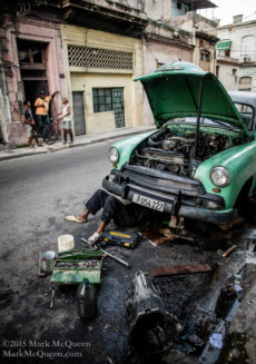 The thousands of classic cars in Havana require constant upkeep. This is a common scene all over Havana.