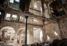Huge, cavernous ruins of once-glorious buildings dot the landscape of Havana.