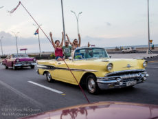 Tourists on the famous Malecone in Havana Cuba